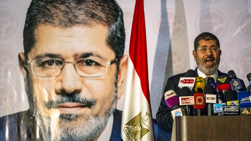 The Muslim Brotherhood on Sunday claims its candidate, Mohamed Morsi, has defeated foe Ahmed Shafik to become Egypt's president.