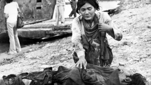 A woman cries next to a dead body in Phnom Penh after the Khmer Rouge enter the Cambodian capital.