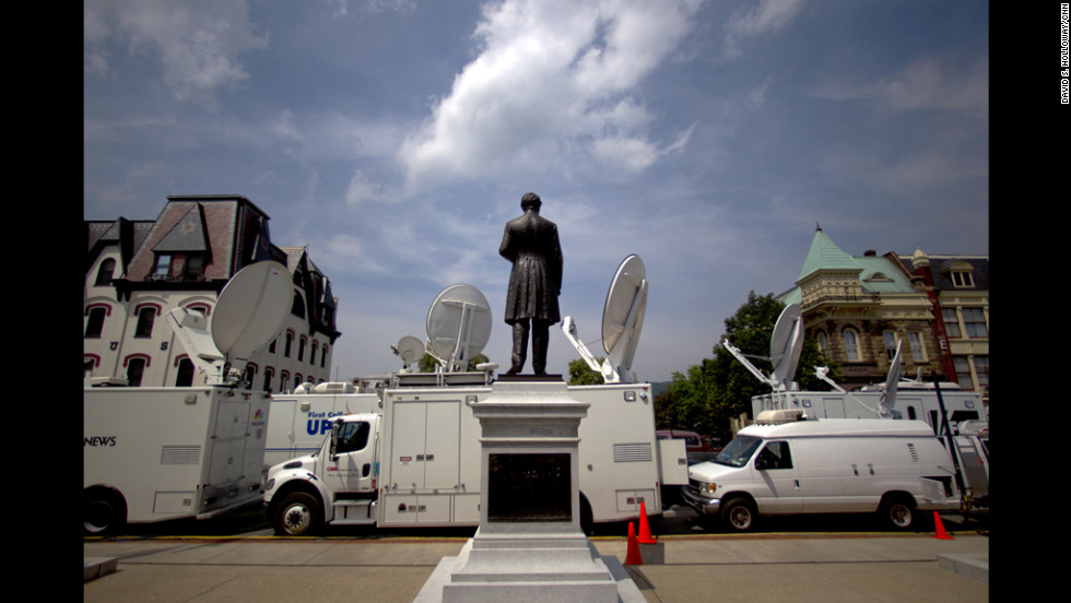 Several news vans pile up outside of the Sandusky trial. The network satellite vans are all parked in front of the Centre County Courthouse and the vans parked in back are live trucks from the regional news outlets.