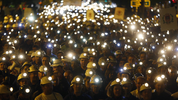 The streets of Leon in northern Spain light up as thousands of coal miners march with their helmet lights on. The protest on June 12, 2012 was part of a nationwide miners