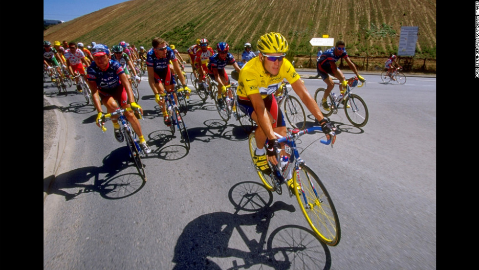 Armstrong leads his teammates during the final stage of the 1999 Tour de France.