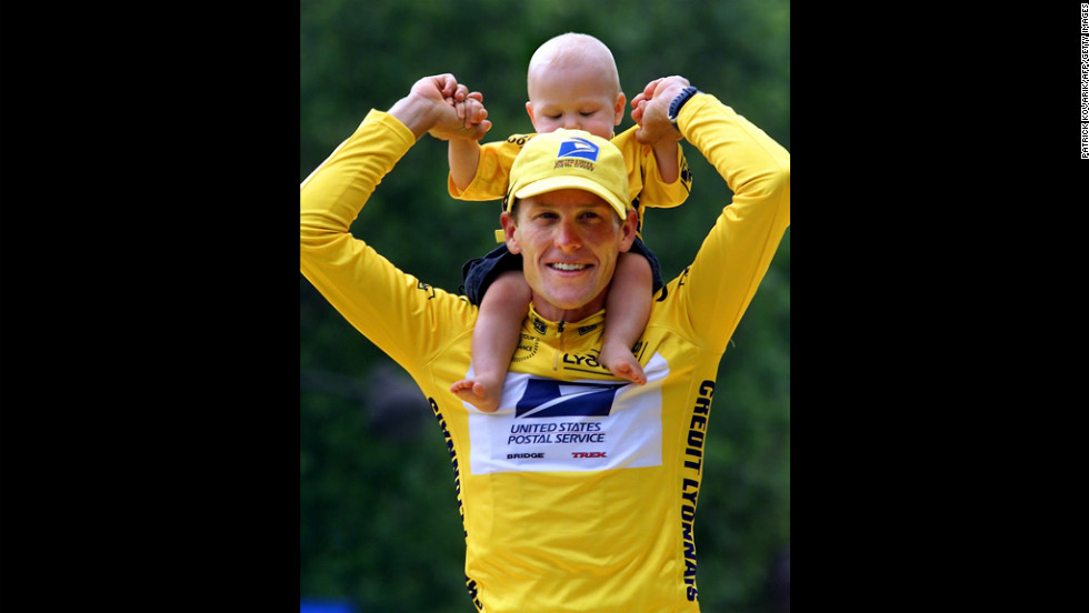 After winning the 2000 Tour de France, Armstrong holds his son Luke on his shoulders.
