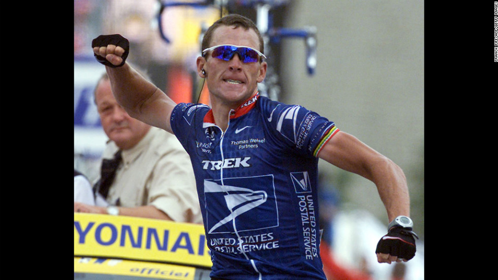 Armstrong celebrates winning the 10th stage of the Tour de France in 2001.