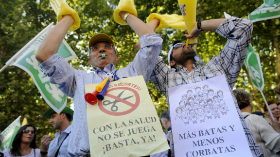 Health workers in Seville protest against government austerity measures on June 12, 2012. The campaigners display banners saying