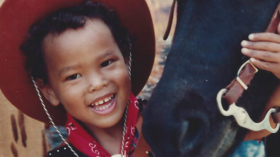 An early picture of the young Bryan Clay with his cowboy hat and a friendly horse.