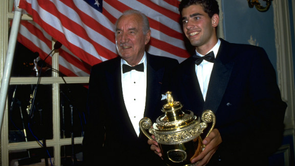 Sampras won his first Wimbledon trophy in 1993, and is pictured here with Britain's last male winner Fred Perry, who collected his third title at SW19 in 1936.