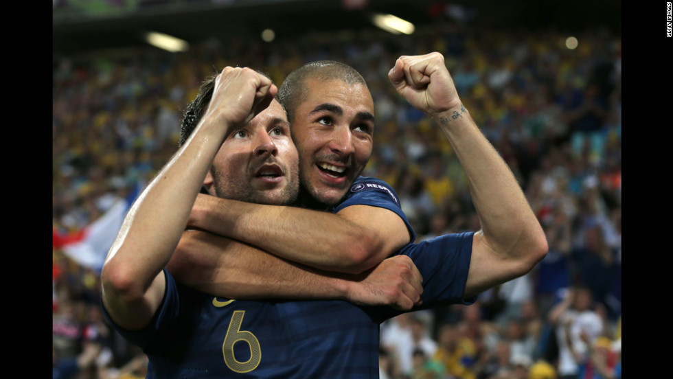 Yohan Cabaye of France celebrates a goal with Karim Benzema of France during the Ukraine-France matchup.