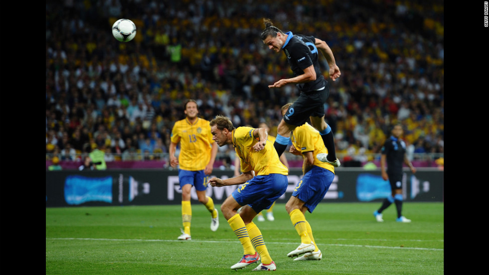 Andy Carroll of England heads the first goal during the match between Sweden and England.