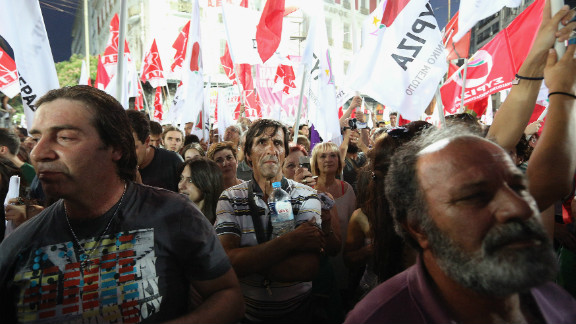 Supporters of the anti-austerity package Syriza party wave flags during a rally ahead of Sunday