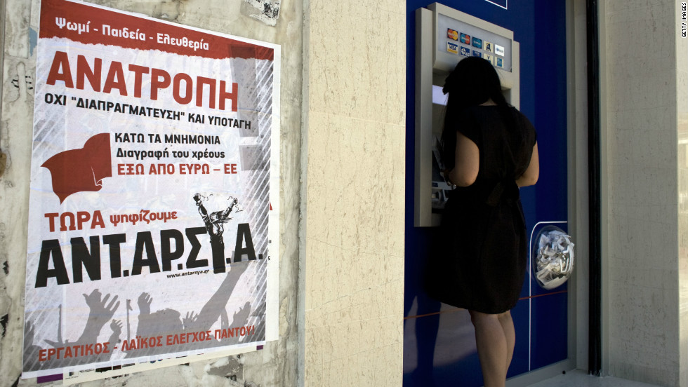 A left wing party election poster calls for Greece to pull out of the European Union and euro, on June 13, 2012 in Athens, Greece. Some Greeks have been withdrawing their money from the country's banks to protect themeselves from the crisis.