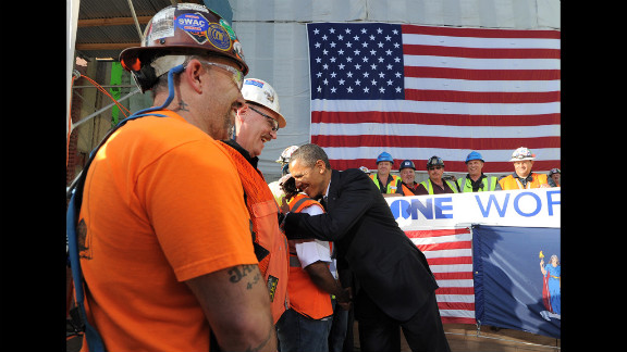 "Obama visits with workers. ""We couldn't be prouder of you guys,"" Obama told them. ""This is what the American spirit is all about."""