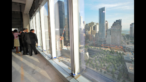 From the 22nd floor, Obama, New York Gov. Andrew Cuomo, New Jersey Gov. Chris Christie and Michelle Obama look down at the September 11 memorial.