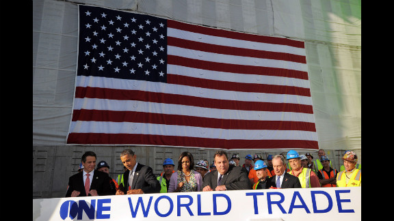 Obama signs a steel beam as, from left, Cuomo, Michelle Obama, Christie and New York Mayor Michael Bloomberg look on.
