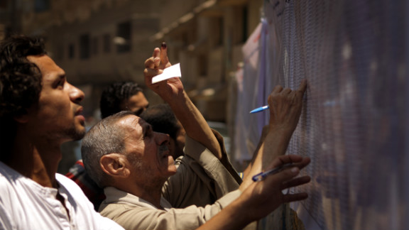 Egyptian Christian Coptic men check the voters