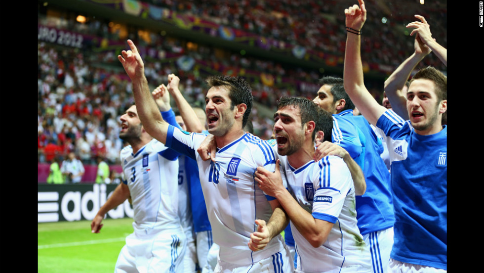 Giorgos Karagounis of Greece, center, celebrates Greece's victory over Russia and and adnvancement to the quarter finals during the match between Greece and Russia.
