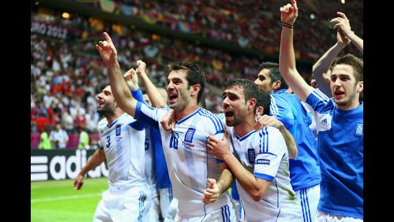 Giorgos Karagounis of Greece, center, celebrates Greece