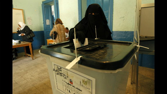 A full-veiled Egyptian woman casts her vote at a polling station in Cairo on June 16.