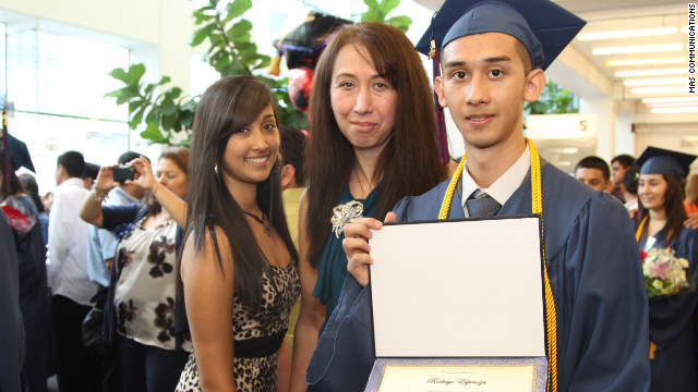 Rodrigo Espinoza with his mother, Marcela, and sister Jacqueline at the graduation ceremony of Hector P. Garcia High School.