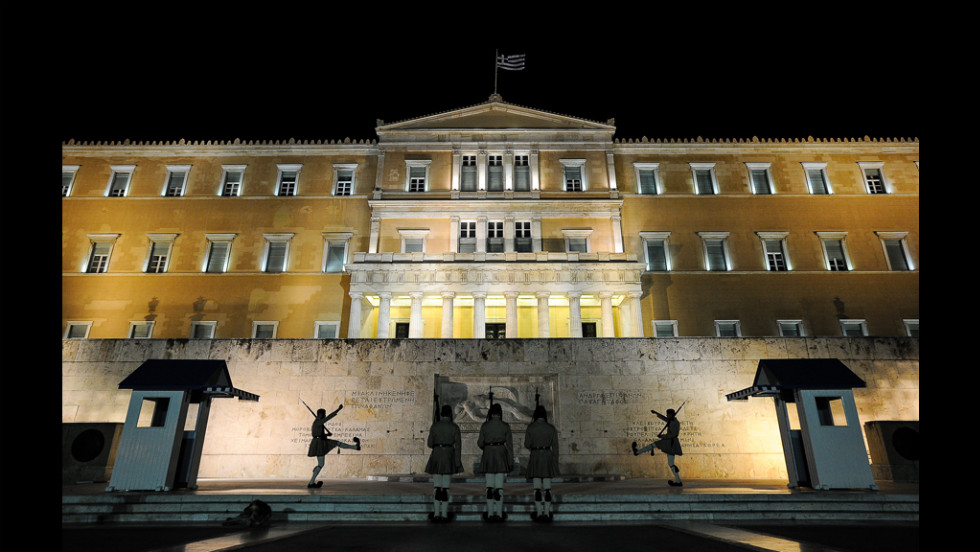 A night before the election, a changing of the guards takes place in front of the Greek parliament in central Athens on Saturday, June 16.