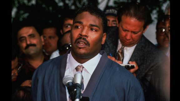 Rodney King pleads for rioters to end the violence during a news conference in front of his lawyer