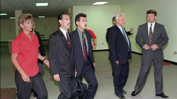 Officers Theodore J. Briseno, second from left, is escorted out of the courthouse on April 29, 1992 after being acquitted of all charges. Laurence M. Powell, right, was acquitted of all but one charge. Hours after the officers