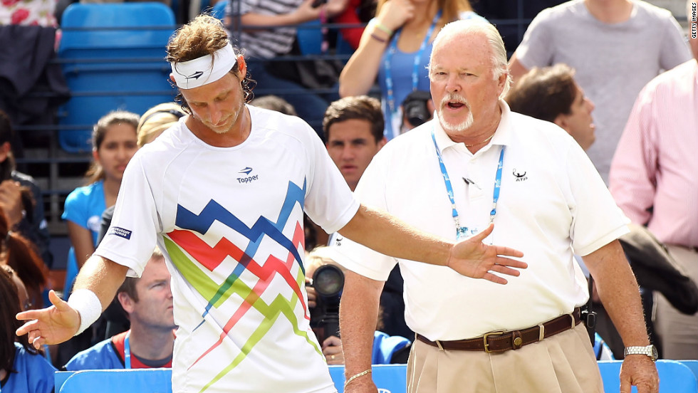 Nalbandian learns his fate from ATP official Tom Barnes as he is disqualified for 'unsporting behavior'