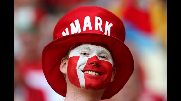 A Danish fan enjoys the atmosphere ahead of the team
