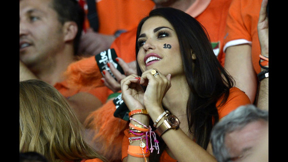 A Dutch fan makes a heart shape with her hands before the start of the team