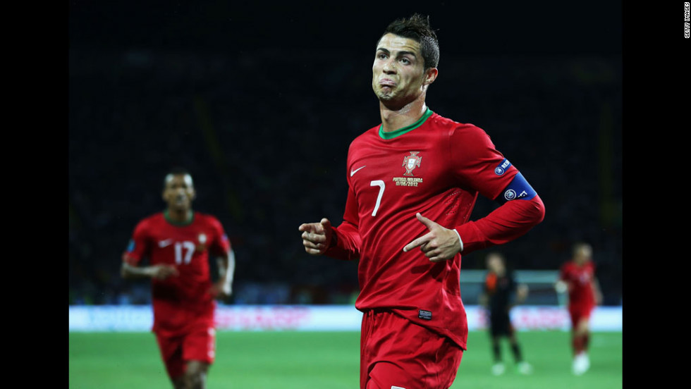 Cristiano Ronaldo of Portugal celebrates scoring the first goal against the  Netherlands.