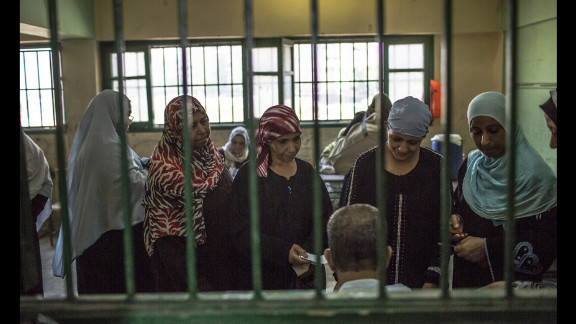 Women line up to vote at a polling station in Cairo, Egypt, on the second and final day of the run-off presidential election.