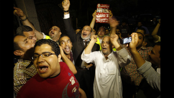 Morsi supporters celebrate Monday in Cairo. Votes in the Egyptian capital, the largest population center, continued to be tallied, but unofficial results by a state-run news website showed Morsi leading elsewhere with 11.2 million votes, compared with 10.3 million for Ahmed Shafik, the last prime minister in the waning days of Mubarak
