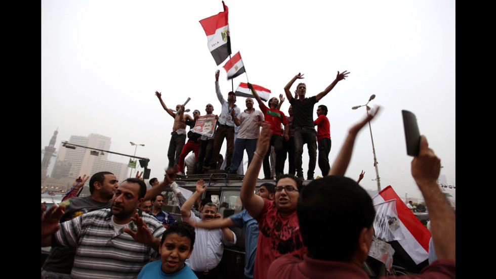 Morsi supporters wave flags Monday in Cairo's Tahrir Square after the Islamists claimed victory.  The square was considered the heart of the February 2011 uprising that led to Hosni Mubarak's downfall.