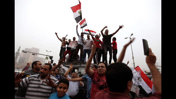 Morsi supporters wave flags Monday in Cairo