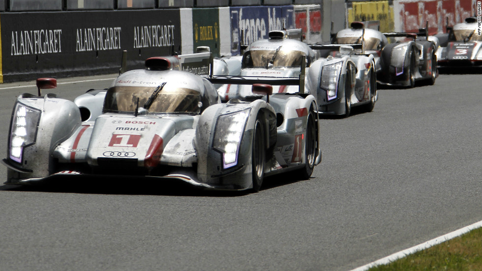 Audi made history at the Le Mans 24 hour race, with the R18 car becoming the first hybrid vehicle to win the endurance event.