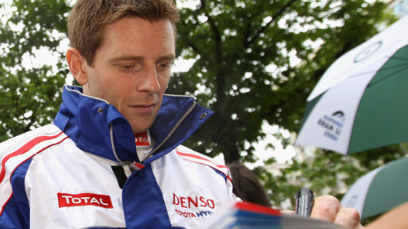 Toyota driver Anthony Davidson, seen here signing autographs pre-race, was involved in a horrific crash during the race. The Briton broke his back, and admitted he felt lucky to be alive after the incident.