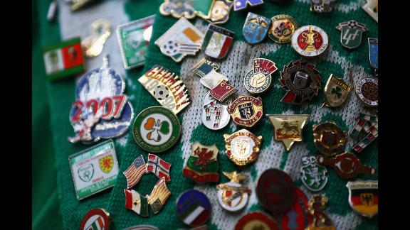 Badges adorn an Ireland fan