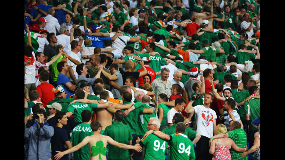 Ireland fans do the Poznan as they enjoy the atmosphere during the match against Italy.