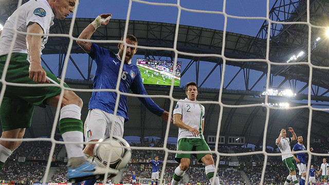 Republic of Ireland's Damien Duff fails to prevent Antonio Cassano's header from crossing the line for Italy's opening goal