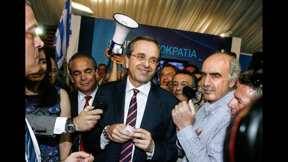 New Democracy leader Antonis Samaras smiles at supporters in Athens on Sunday, June 17. His center-right, pro-bailout party came out on top in the country