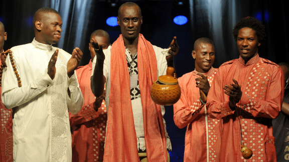 Senegalese designer Amdou Diop, center, thanks the crowd following his show.
