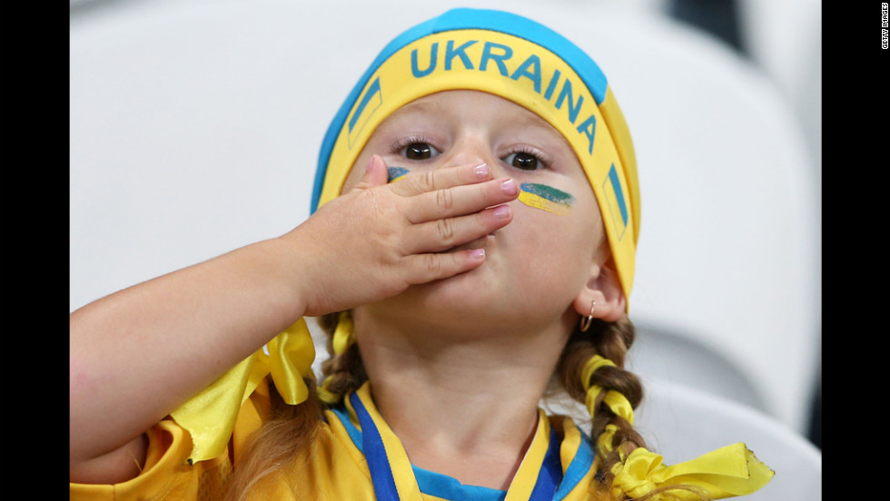 A young Ukraine fan shows enthusiasm ahead of the match between England and Ukraine on Tuesday, June 19.