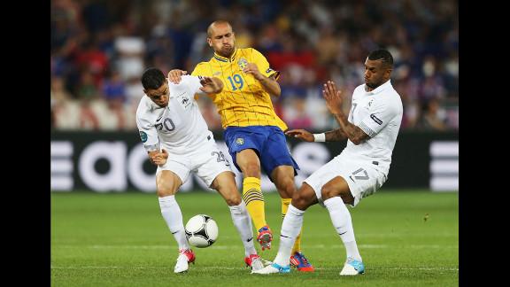Emir Bajrami of Sweden gets tackled by France