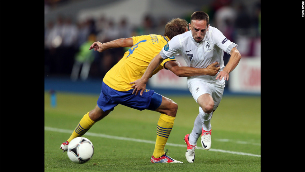 Franck Ribery of France goes past Andreas Granqvist of Sweden during the match between Sweden and France.