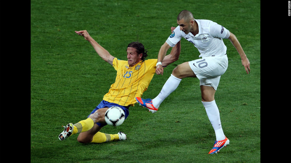 Karim Benzema of France is challenged by Jonas Olsson of Sweden during the match between Sweden and France.