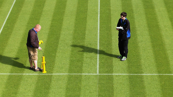 Wimbledon ground staff conduct a test to determine how the ball is bouncing on a court.