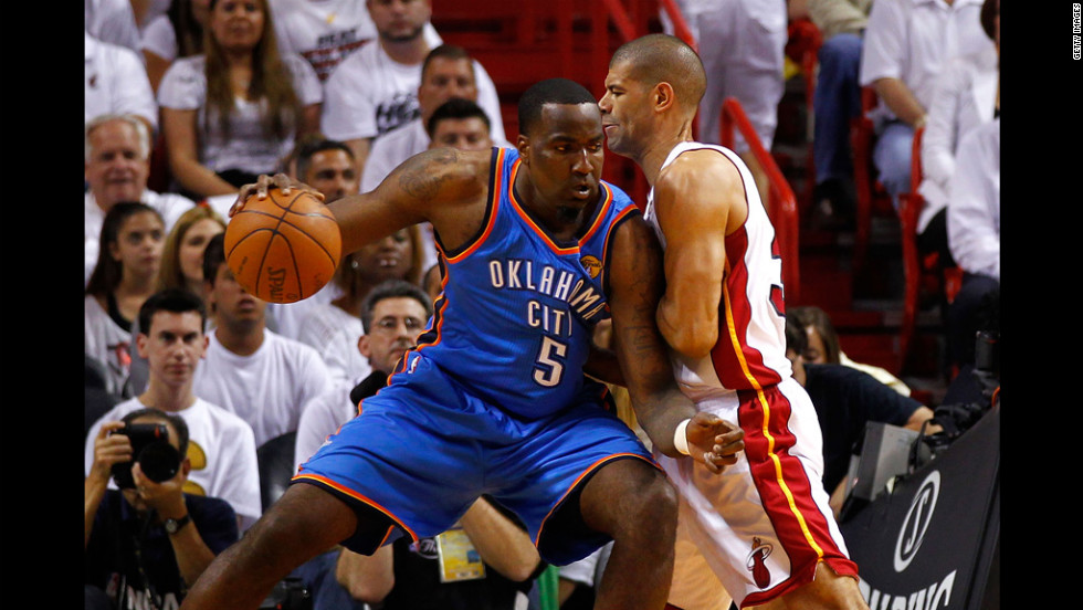 Kendrick Perkins, No. 5 of the Thunder, posts up in the first quarter against Shane Battier, No. 31 of the Heat.