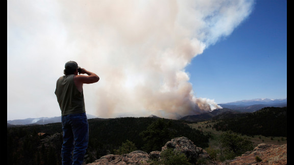 Local resident Dwayne Crawford looks out at the High Park Fire from his home west of Fort Collins on June 19.