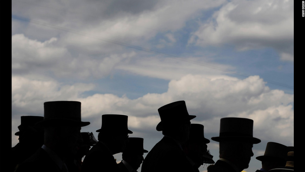 Top hats are worn by race-goers at the Royal Ascot in England on Wednesday, June 20. The five-day meeting is one of the highlights of the horse racing calendar and the season. Thousands of race fans are expected to attend.