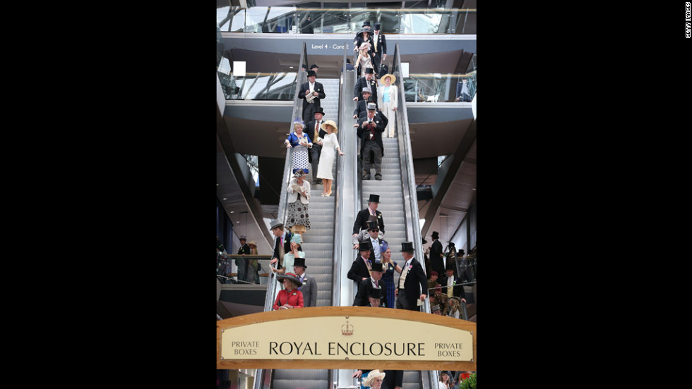 Race-goers ride an escalator down from the private boxes of the Royal Enclosure.