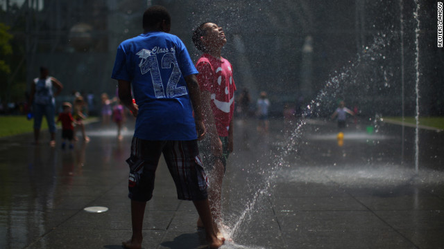 Children play at a fountain Wednesday in New York, where temperatures reached the mid-90s.